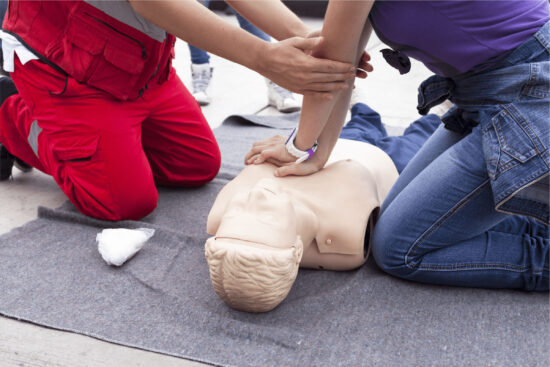 Emergency Workers performing First Aid on dummy