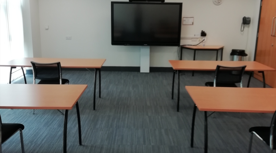 Desks and TV in room